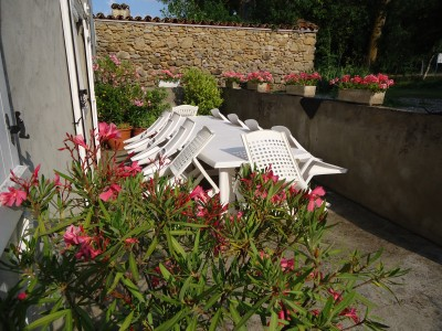 Southfacing, sunny terrace  -   and very flowery.   Great for breakfast and late in the evening.